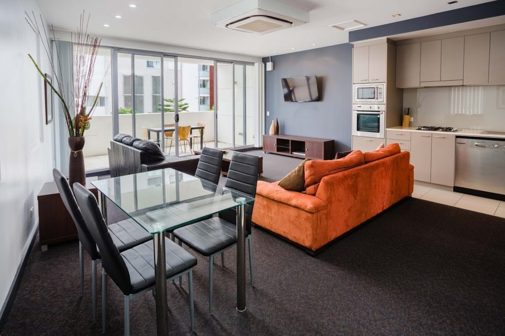 Honeysuckle Executive Suites - https://www.newcastleapartments.com.au/wp-content/uploads/2019/01/AW103-Loungeroom-1024x683.jpg