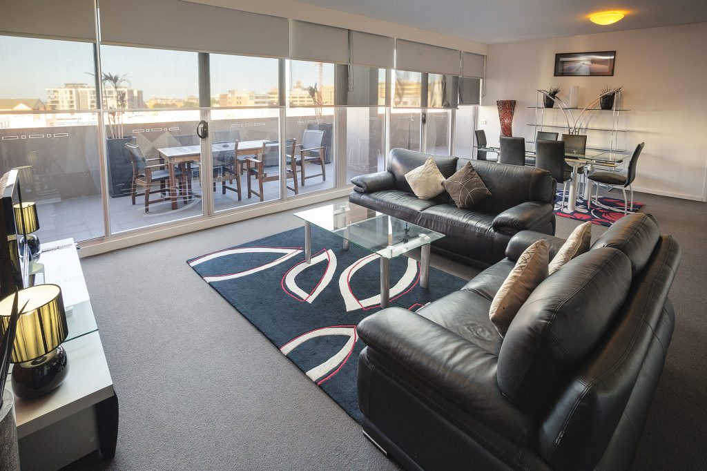 Honeysuckle Executive Apartments - https://www.newcastleapartments.com.au/wp-content/uploads/2019/01/honeysuckle-executive-apartments-living-room-1024x682.jpg