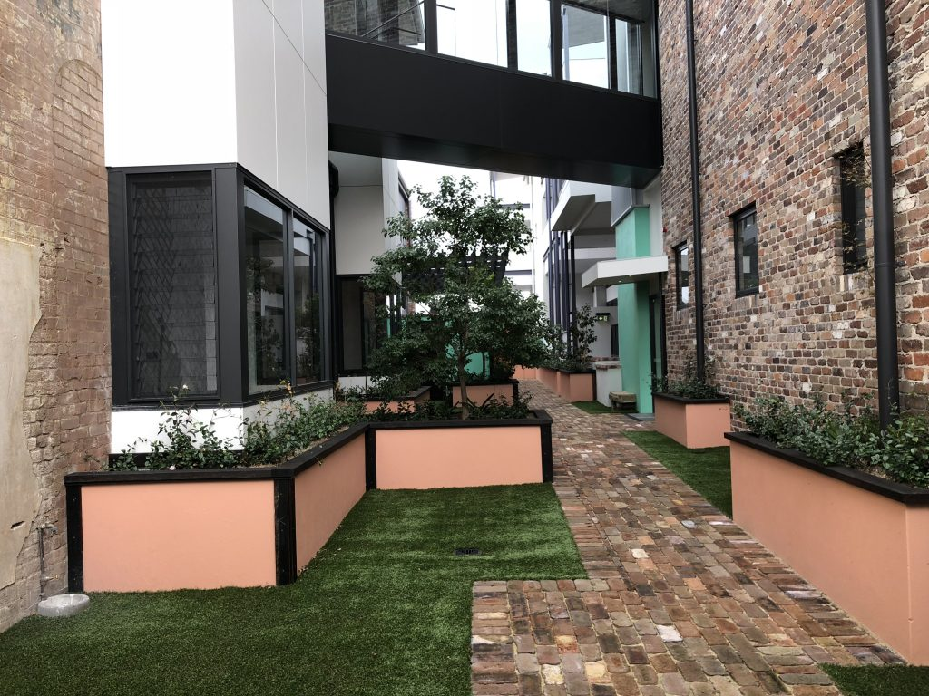 Atrium - https://www.newcastleapartments.com.au/wp-content/uploads/2019/02/Walk-down-the-footpath-to-the-1st-glass-door-on-the-right-hand-side-1024x768.jpg