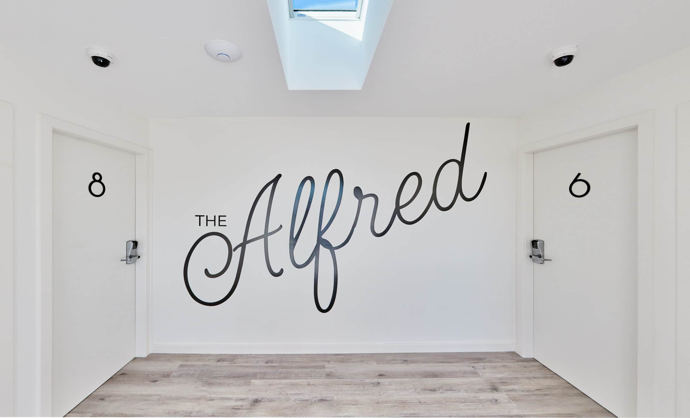 Alfred Apartments - https://www.newcastleapartments.com.au/wp-content/uploads/2019/08/sign-scaled.jpg