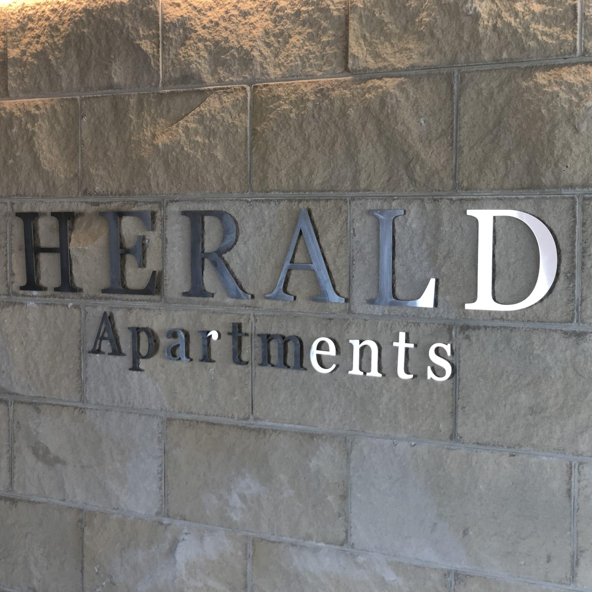 Herald Apartments - https://www.newcastleapartments.com.au/wp-content/uploads/2019/12/Sign-scaled.jpg
