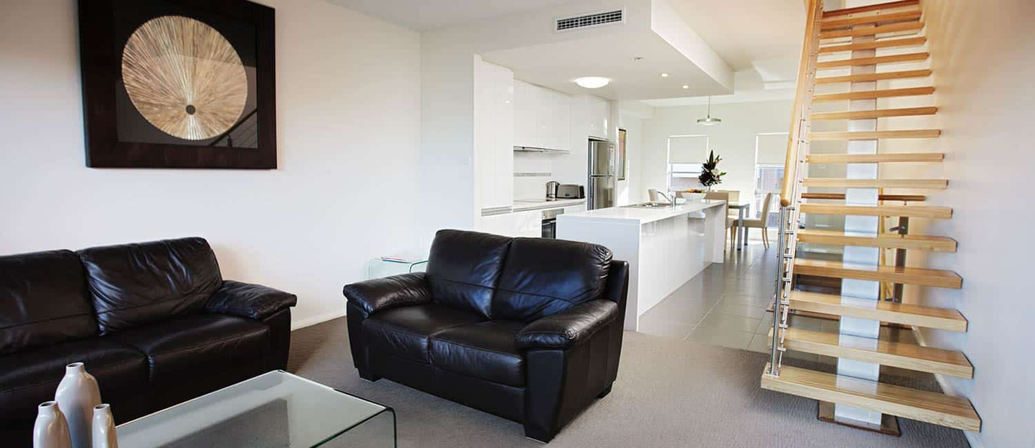 Charlestown Executive Apartments - https://www.newcastleapartments.com.au/wp-content/uploads/2020/01/charlestown-apartment-living-kitchen.jpg