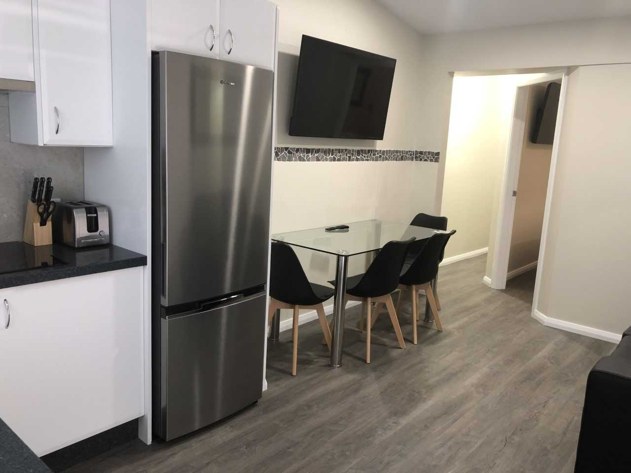 Callaghan Cottages - https://www.newcastleapartments.com.au/wp-content/uploads/2020/02/fridge.jpg